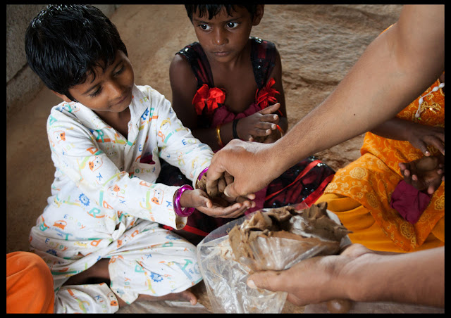 Volunteers distributing Clay to kids