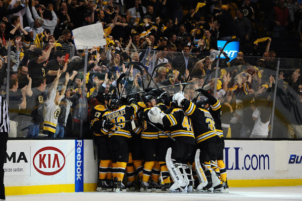 Boston Bruins players celebrate their series win over the Toronto Maple Leafs