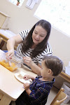 Toddler Montessori Parent & Child classrooms offer a group snack for toddlers to learn how to set the table, serve themselves, dine together and clean-up!