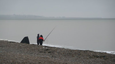 Fishermen braving the ghostly Dunwich beach