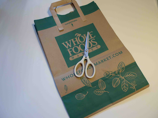Start with a paper grocery bag and a sharp pair of scissors.