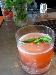 On The Veranda Cocktail from the Bent Brick, Portland OR with mint, strawberry, simple syrup, rhubarb cordial, sage liquor, white verjus, and gin