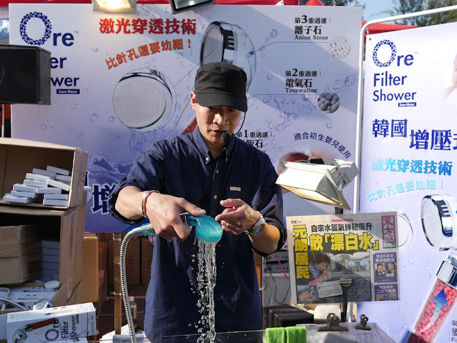man demonstrating a shower water filter