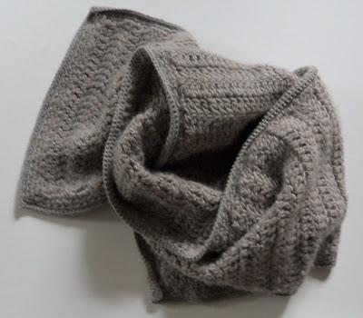 Close up grey crochet scarf, very plain stitch.
