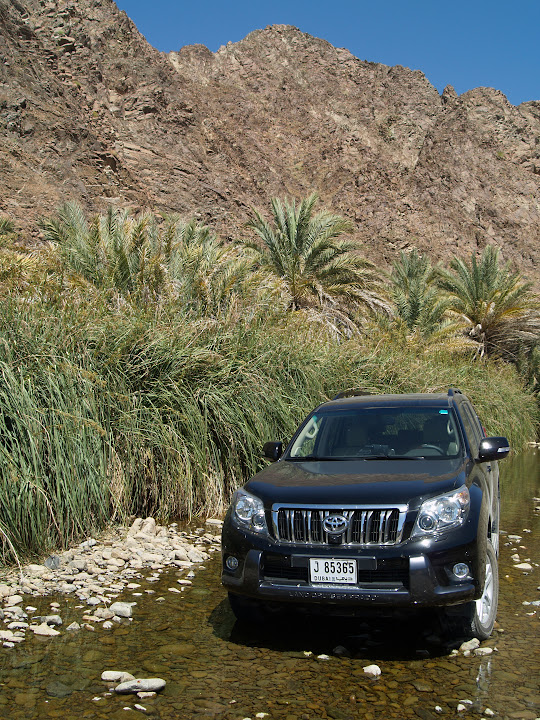 Toyota Prado poses in Wadi Jazira, upstream of the man-made dam and tight gorges.