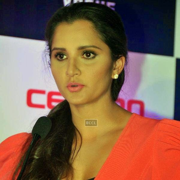 Sania Mirza clicked during the launch of Celkon's Millennium Vogue Q455 in Mumbai, on July 25, 2014. (Pic: Viral Bhayani)