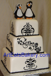 Two tier black and white fondant square custom wedding cake design with handcrafted Bride and Groom pengiun topper picture