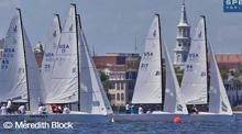 J/70 sailing along city front