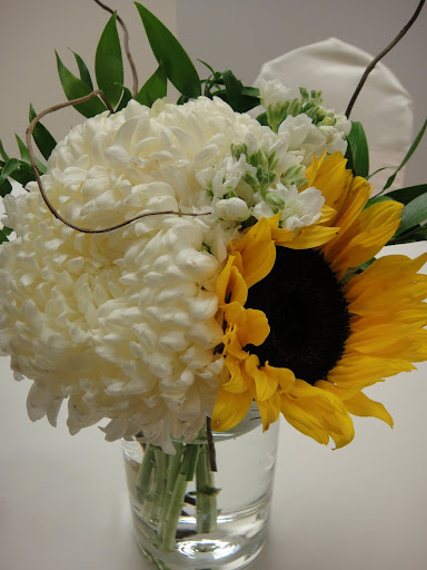 Arrangement with football mum, sunflower, and stock