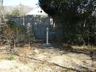 Landfills and residential areas are often close. Here a gas monitoring well is installed between a landfill and adjacent residence to provide early warning of gas migration toward the structure.