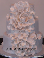 Platinum pearl fondant wedding cake with dramatic white and platinum hand crafted edible sugar flower