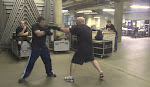 More boxing training.  Kevin smiles when Pat hits him