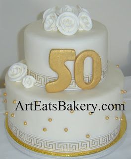 Two tier white and gold fondant unique aniversary cake with edible sugar rose flowers, pearls and 50 idea picture