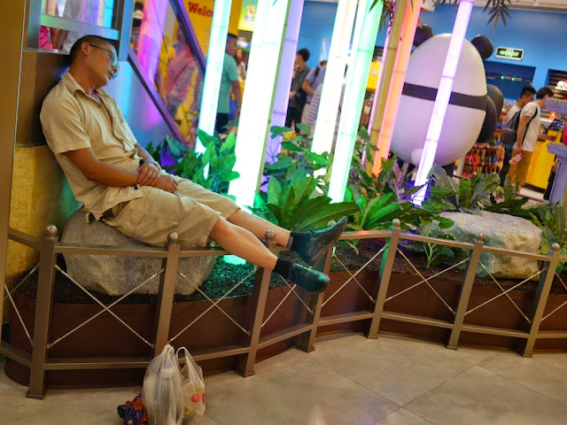 man sleeping at the M&M's World in Shanghai