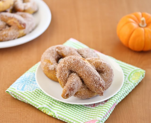 photo of two Cinnamon Pumpkin Soft Pretzels on a plate