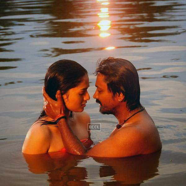 Sunaina and Kreshna in a still from the Tamil movie Vanmham.