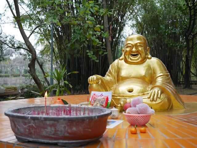 smiling Buddha statue at Beihai Park
