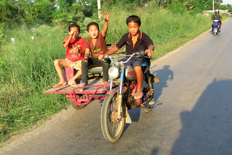 Three boys on a motorbike with a sidecar