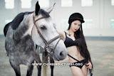 Chinese Female Model and Horse Photo 1