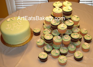 Custom designed green fondant wedding cake and cupcake tower with butterflies and flowers