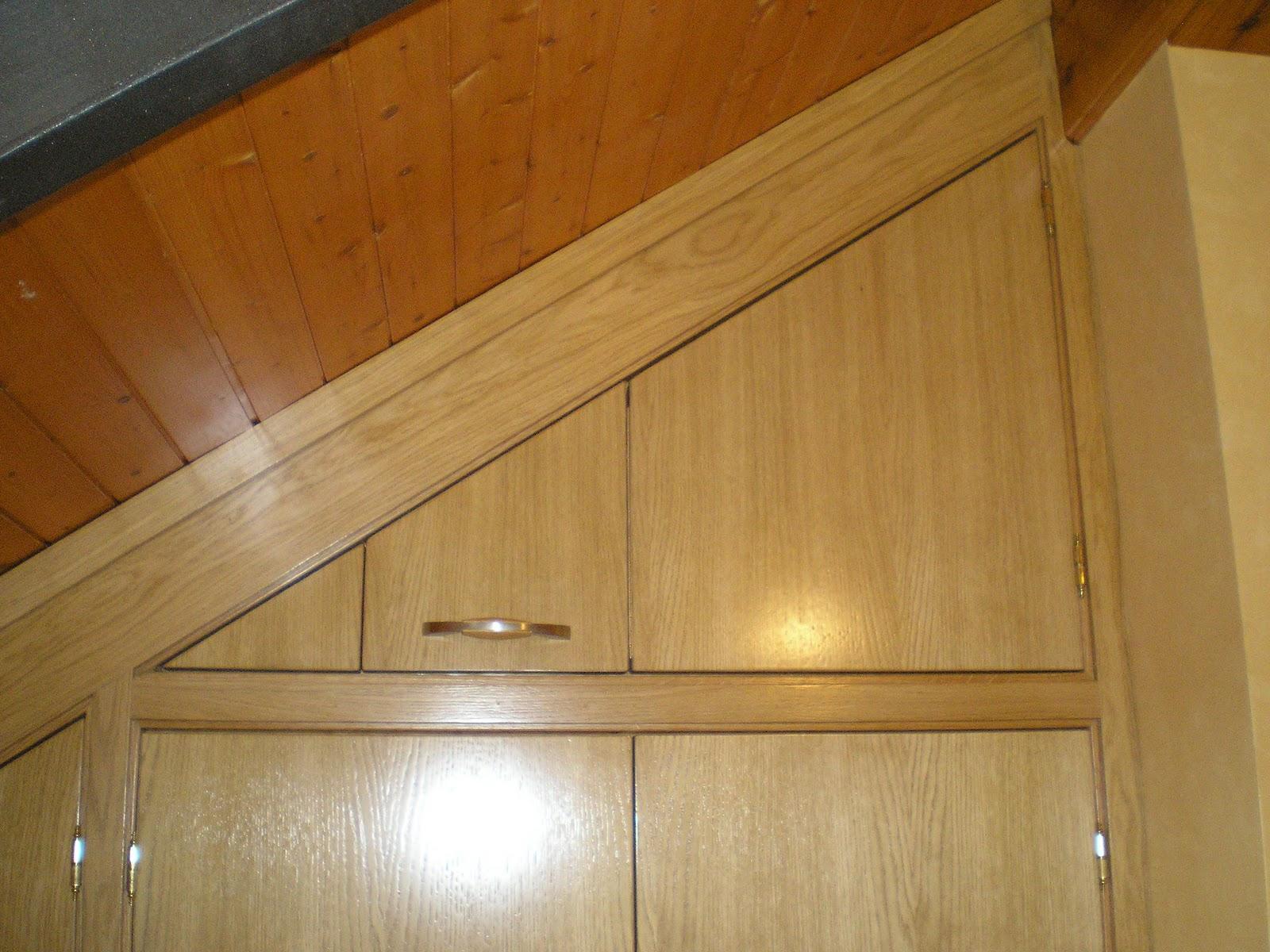 Ebanisteria dmh montajes armarios para buhardillas con - Armarios con puertas abatibles ...