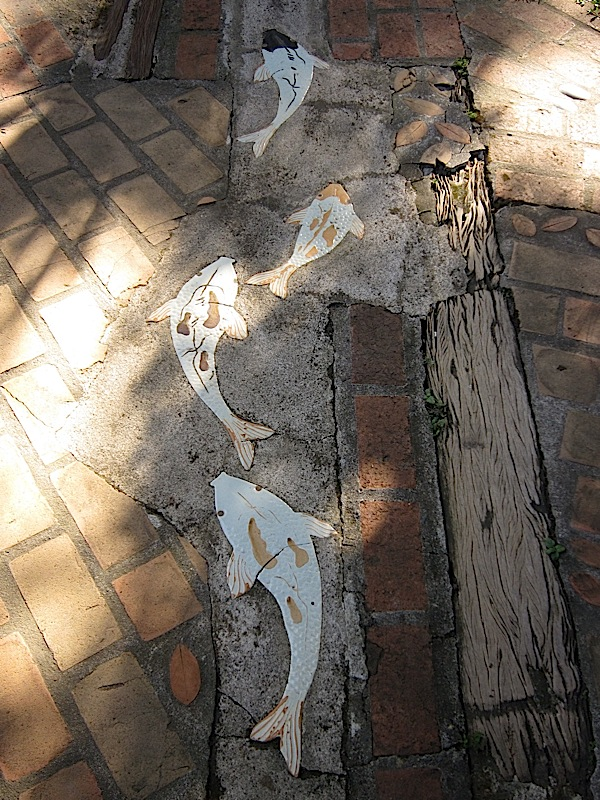 ceramic fish on a path in Ugu Bigyan Potter's Garden