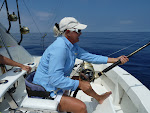 Linda Wilson fighting a Blue Marlin that was released in the 5th Annual Hospice of Kona's Tournament