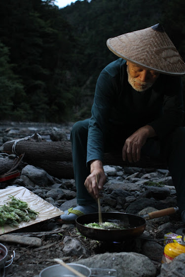 Mr. Sebata cooking wild mountain vegetable tempura after day of tenkara