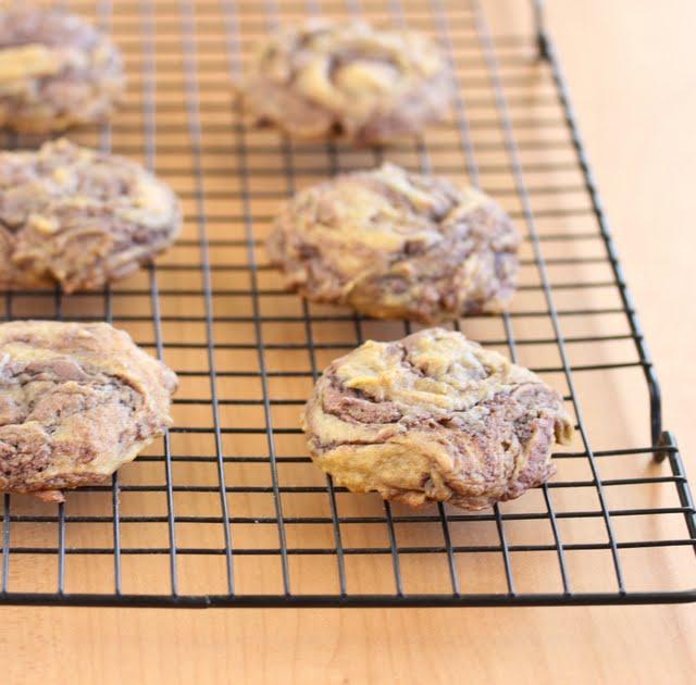 photo of Pumpkin Nutella Swirl Cookies on a baking rack