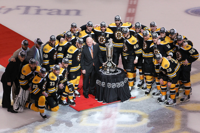 The Boston Bruins posing for pictures with the Prince of Wales trophy