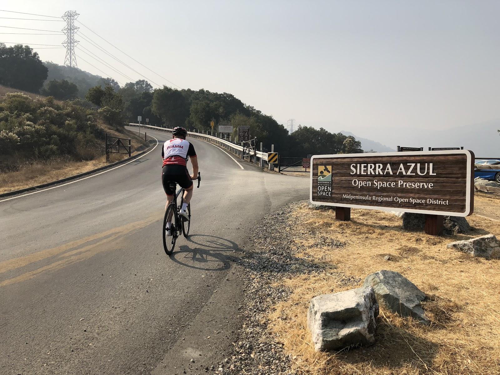 Cycling Mt. Umunhum - PJAMM cyclist on bike entering Sierra Azul Open Space Preserve on Mt. Umunhum Road