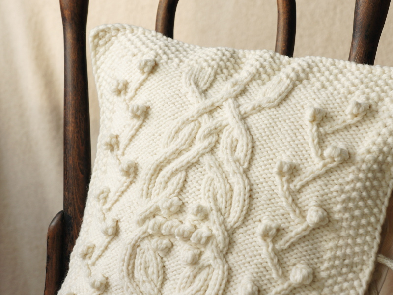 White knitted aran pillow