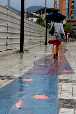 Woman walking in Tirana Albania