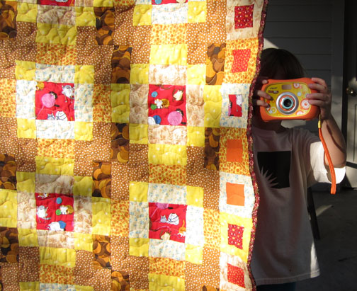taking pictures of the cat quilt
