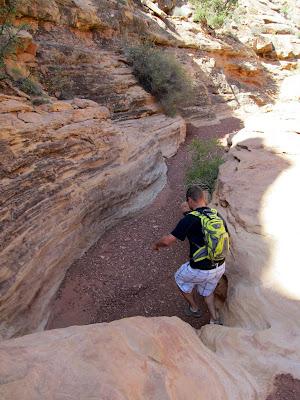 Chris jumping down a small drop