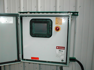 A custom-built remediation system for a gas station showing system shutdown control and data readout panel.