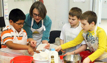 Sharon with kids baking
