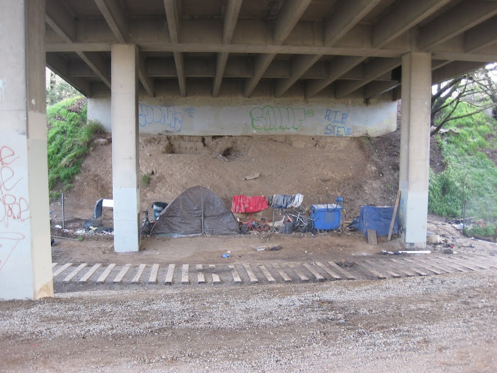 A makeshift homeless camp under State Route 160 near Del Paso Blvd.