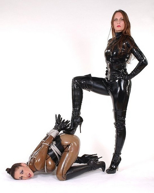 black latex mistress in thigh high boots