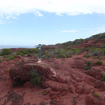 Arrow marker on red cliffs (105430)
