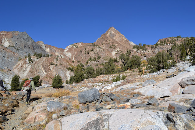 pyramid of rock beside the trail ahead