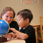 The Montessori geography curriculum starts with the Sandpaper Globe. This three-year-old boy is fascinated as he touches the rough surface of the continents, and discover that the sandpaper indicates where land is on the earth.
