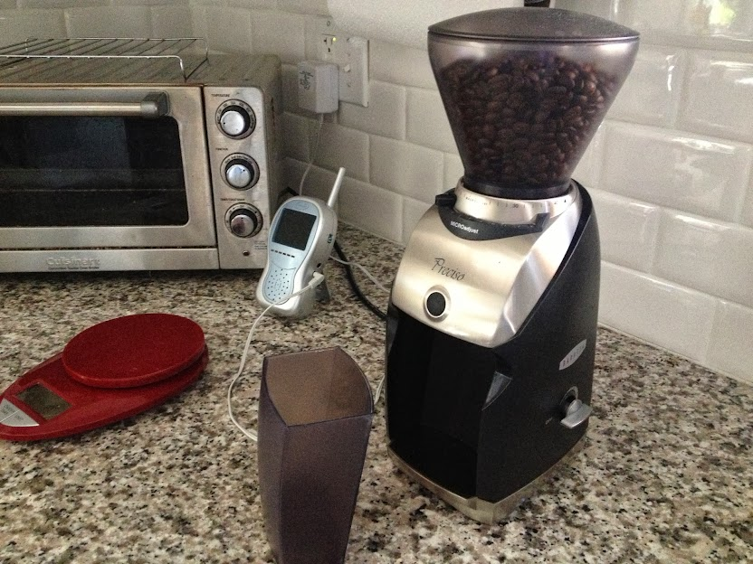 The Baratza Preciso Conical Burr Coffee Grinder sitting on our counter top with the hopper designed to collect ground coffee.
