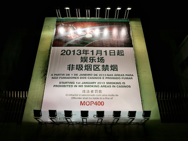 "sign reading ""Starting 1st January 2013 smoking is prohibited in no smoking areas in Casinos. Offender shall be liable to a fine of MOP400."