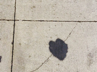 black heart on sidewalk