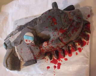 "A ""Gears of War"" Lancer cake, complete with edible blood"