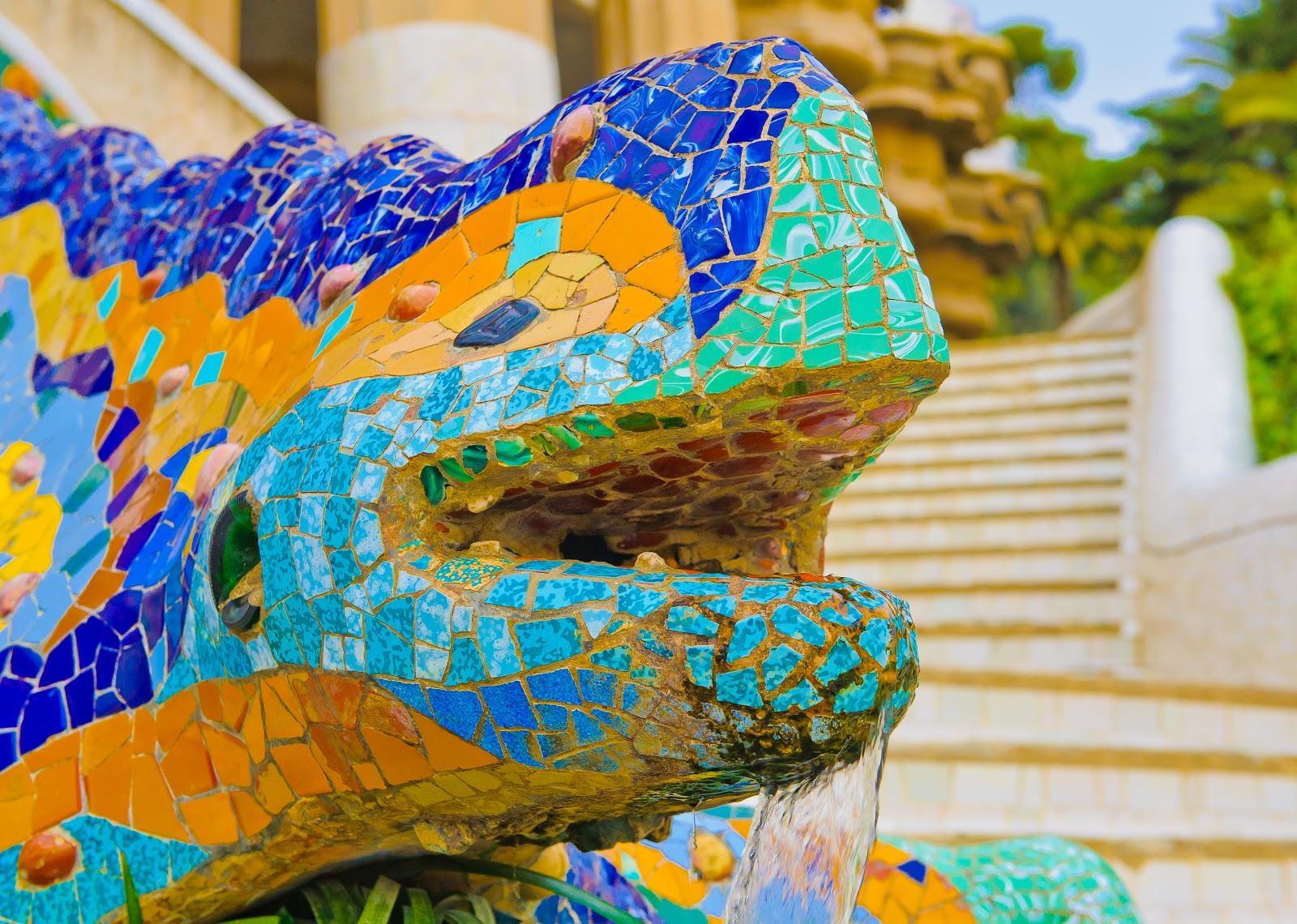 A close up photo of El Drac, the Park Guell lizard sculpture.