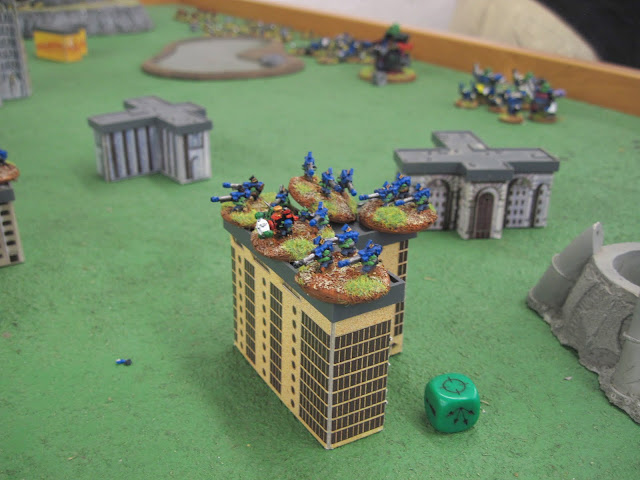Karl's Big Gunz hold down a building.
