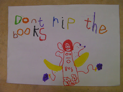 library book warning sign, don't rip the books