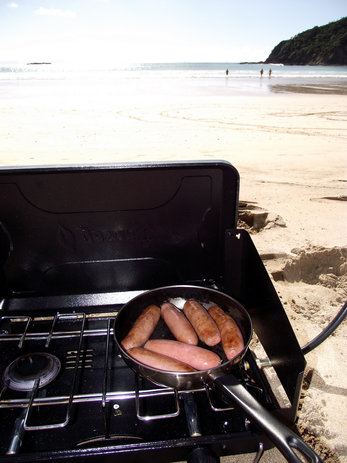 chaggie and parsons got their camping gear out frying pan stove gas cylinder and out came the sausages a sausage sandwich later and we were on the beach chaggie downunder february 2011 evening